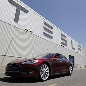 File photo of a Tesla Model S outside the Tesla factory in Fremont, Calif. (© Paul Sakuma/AP)