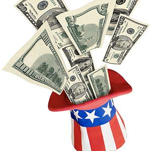 Taxes flowing into Uncle Sam's hat © Thinkstock/SuperStock