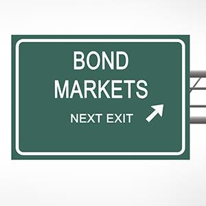 Credit: © vaeenma /Getty ImagesCaption: Road sign to bond market