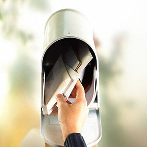 Mailbox full of mail © Corbis