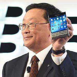 Credit: © Aaron Harris/ReutersCaption: BlackBerry Chief Executive John Chen introduces the Passport smartphone during an official launch event in Toronto, September 24, 2014