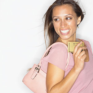 Smiling woman with credit card © Burke/Triolo Productions/BrandX/Getty Images