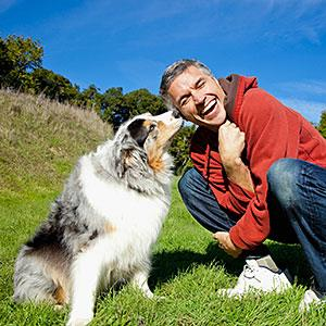 Man with dog © VStock LLC, Tanya Constantine, Tetra images, Getty Images
