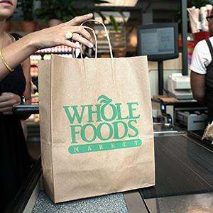A customer checks out of a Whole Foods Market in Washington, D.C. © Andrew Councill/Bloomberg via Getty Images