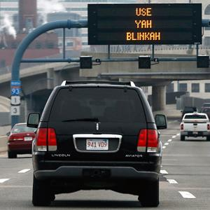 'Use Yah Blinkah' sign on Interstate 93 in Boston on May 9 (© Michael Dwyer/AP)