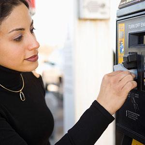 Buying gas © Somos Image, Corbis