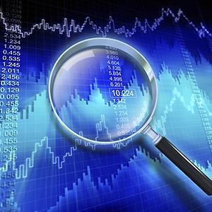 Examining financial data through a magnifying glass © Henrik Jonsson/Getty Images