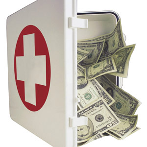 Money in a medical emergency kit © Comstock Images, Jupiterimages