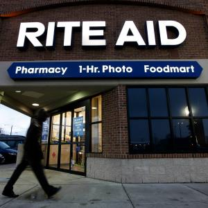 In this Dec. 15, 2009 file photo, a customer enters a Rite Aid store in Detroit. (c) AP Photo/Paul Sancya
