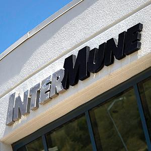 InterMune Inc. signage is displayed outside of the company's headquarters in Brisbane, Calif., Aug. 15, 2014 © David Paul Morris/Bloomberg via Getty Images