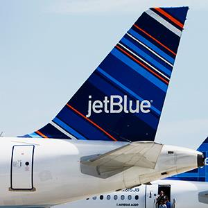 Caption: A JetBlue Airways Corp. plane in Long Beach, Calif.