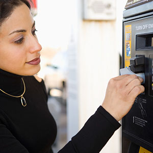 Buying gas © Somos Image, Corbis