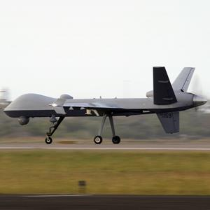 A Predator B unmanned aircraft lands after a mission at the Naval Air Station Nov. 8, 2011, in Corpus Christi, Texas (© Eric Gay/AP Photo)
