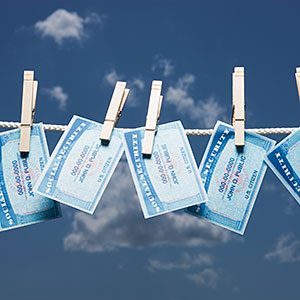 Social Security cards on clothes line © Mike Kemp/Tetra images/Getty Images