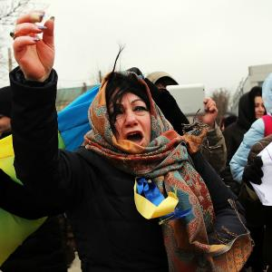 Supporters of Ukraine yell at pro-Russian protesters during a rally in support of the keeping Crimea a part of the Ukraine on March 10, 2014 in Simferopol, Ukraine. (c) Spencer Platt/Getty Images