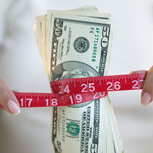 Measuring Finances © Corbis