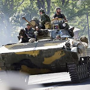A armored vehicle manned by pro Russian rebels leaves Donetsk, Ukraine © Hollandse Hoogte/Corbis