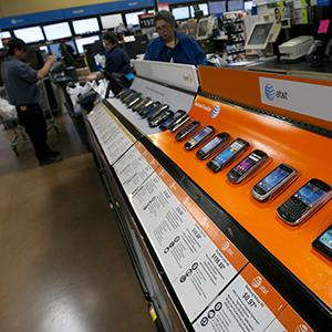 Various smartphone devices at a Wal-Mart in American Canyon, Calif. on Feb. 16, 2012 (© David Paul Morris/Bloomberg via Getty Images)