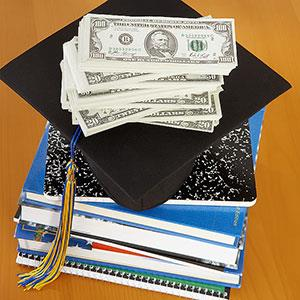 Money on top of a graduation cap © Brand X Pictures, Photolibrary