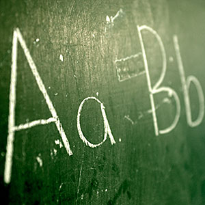 A green chalkboard with the alphabet written on it © Ocean, Corbis