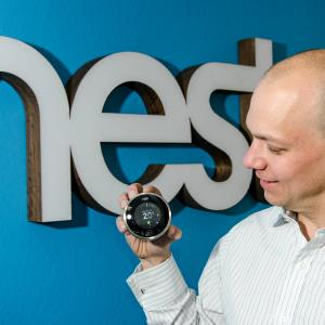 Nest co-founder Tony Fadell holds the company's thermostat in 2012 © Karsten Lemm/dpa/Corbis
