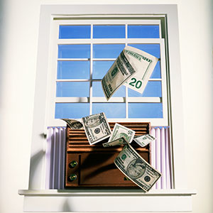 Blowing money out the window © Brian Hagiwara/Brand X/Corbis
