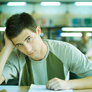 Student in library © Sigrid Olsson, PhotoAlto Agency, Jupiterimages