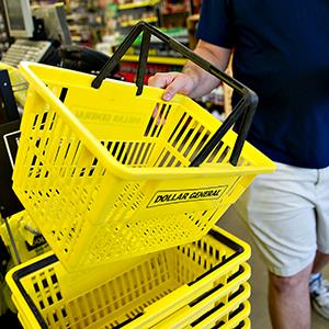 A customer returns a shopping basket at a Dollar General store in Creve Coeur, Ill., on May 31, 2012 (© Daniel Acker/Bloomberg via Getty Images)