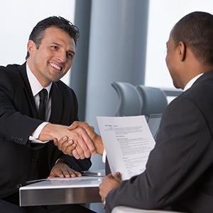 Men shaking hands during business interview, © Ariel Skelley/Getty Images