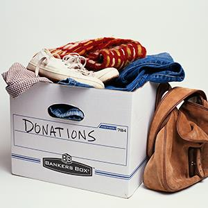 Box of donated clothing © Lisa Romerein/Getty Images