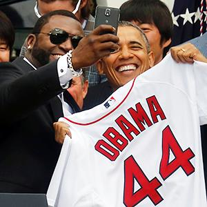 Credit: © Larry Downing/ReutersCaption: President Barack Obama poses with player David Ortiz for a