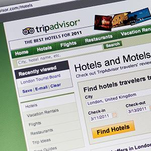 Caption: Tripadvisor website seen on a computer screen