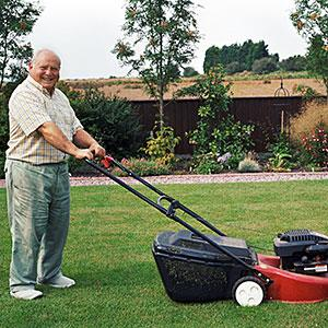 Senior man with lawn mower © Jacobs Stock Photography/Photodisc/Getty Images