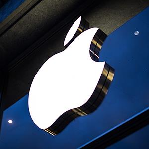 Caption: The Apple logo is displayed at an Apple Store