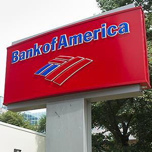 Caption: A Bank of America sign outside a bank branch in Arlington, Va.