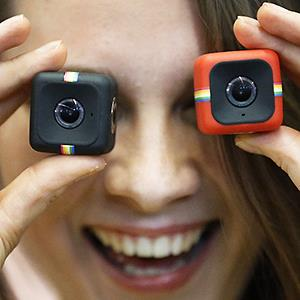 Credit: © Frank Augstein/APCaption: A model shows the new Polaroid Cube cameras