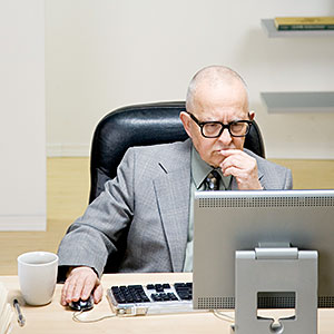 Image: Senior man sitting at desk with computer © Andersen Ross, Brand X Pictures, Getty Images