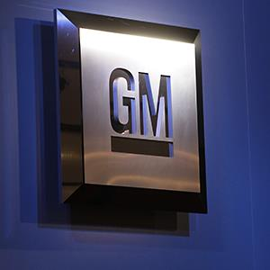 Caption: The General Motors logo is seen on display at an auto show in Detroit