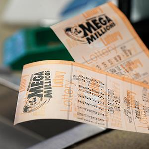 Two Mega Millions lottery tickets. Credit: Jeff Roberson/AP