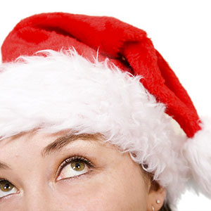 Woman with Santa hat © Ingram Publishing, SuperStock