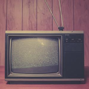 Static plays on the screen of an old 1980's TV