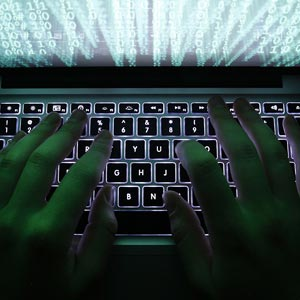 A man types on a computer keyboard in a cyber attack © Kacper Pempel/Reuters