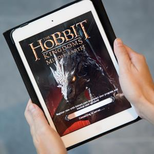A loading page for The Hobbit: Kingdoms Of Middle-Earth, developed by Kabam Inc., is displayed on an Apple iPad © Brent Lewin/Bloomberg via Getty Images