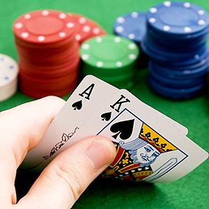 Blackjack hand with Ace & King of spades© Adam Balatoni/Getty Images