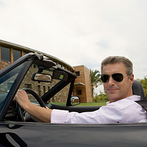 Man sitting in a convertible © Image Source, Getty Images
