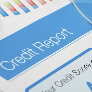 Credit report with score on a desk © Courtney Keating/Getty Images