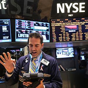 Caption: Traders work on the floor of the New York Stock ExchangeCredit: © Spencer Platt/Getty Images
