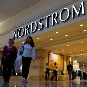 Shoppers make their way past Nordstrom at Woodfield Mall in Schaumburg, Illinois