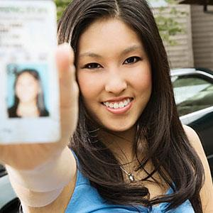 Woman with license © Blend Images, SuperStock