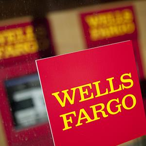 File photo of Wells Fargo & Co. signage at a bank branch in New York (© Scott Eells/Bloomberg via Getty Images)